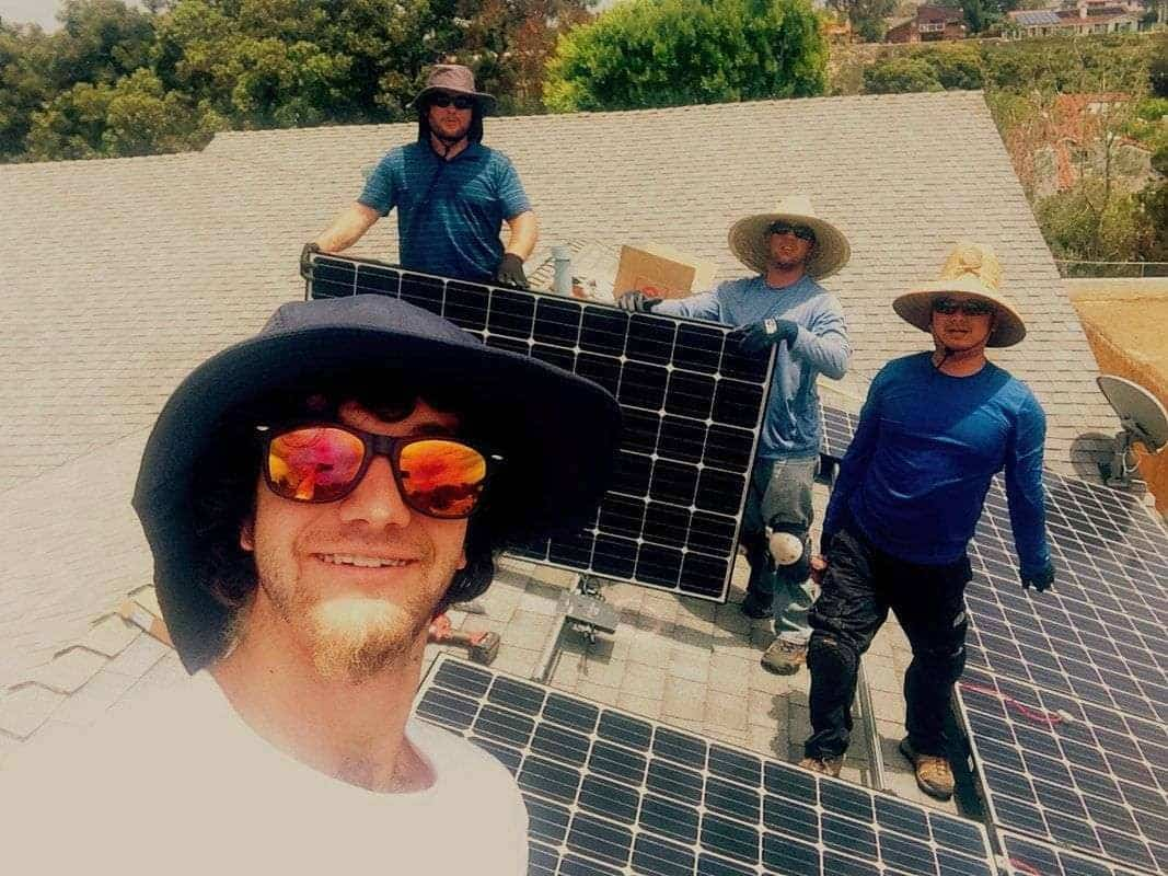 Bryce, Steve, Albert, and Tan complete a 3.355kW with solar panel upgrade in Cardiff.