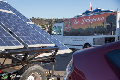Wipomo's Mobile Energy Ecosystem provided off-grid solar power to the Food Truck vendors at the Qualcomm Stadium Swap Meet, while the crowds of visitors enjoyed their meals without the noisy gas generator emissions.